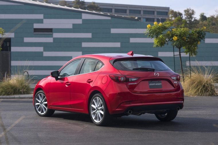 2018 Mazda Mazda3 Grand Touring 5-Door Hatchback in Soul Red Metallic from a rear left view
