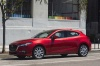 2018 Mazda Mazda3 Grand Touring 5-Door Hatchback in Soul Red Metallic from a front left three-quarter view