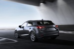 2018 Mazda Mazda3 Grand Touring 5-Door Hatchback in Machine Gray Metallic - Driving Rear Left View