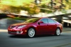 Driving 2010 Mazda 6s in Sangria Red Mica from a front left three-quarter view