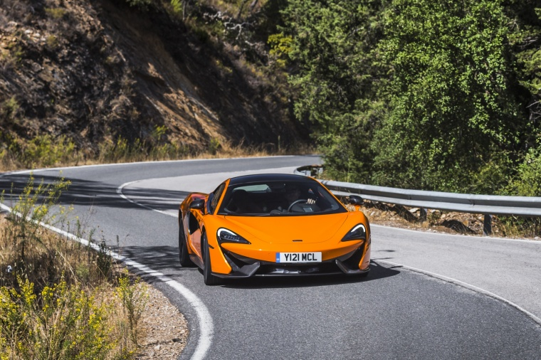 Driving 2017 McLaren 570S Coupe in Ventura Orange from a front right view