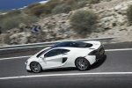 2017 McLaren 570GT Coupe in Pearl White - Driving Rear Left Three-quarter Top View