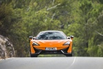 2017 McLaren 570S Coupe in Ventura Orange - Driving Frontal View