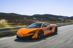 2017 McLaren 570S Coupe in Ventura Orange - Driving Front Left View