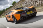 2017 McLaren 570S Coupe in Ventura Orange - Driving Rear Left Three-quarter View