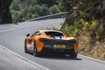 2017 McLaren 570S Coupe in Ventura Orange - Driving Rear Left View