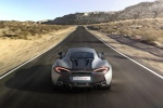 2017 McLaren 570S Coupe in Blade Silver - Driving Rear View