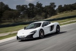 2016 McLaren 650S Coupe in White - Driving Front Left Three-quarter View