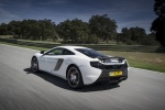 2016 McLaren 650S Coupe in White - Driving Rear Left Three-quarter View