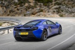 2016 McLaren 650S Coupe in Aurora Blue - Driving Rear Right Three-quarter View