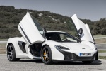 2016 McLaren 650S Coupe with doors open in White - Static Front Right Three-quarter View