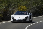 2016 McLaren 650S Spider in White - Driving Front Left View