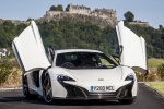 2016 McLaren 650S Coupe with doors open in White - Static Frontal View