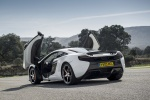 2016 McLaren 650S Coupe with doors open in White - Static Rear Left Three-quarter View