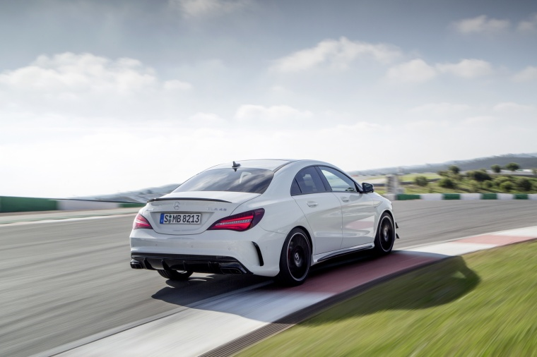Driving 2017 Mercedes-Benz AMG CLA45 4-door Coupe in Cirrus White from a rear right view