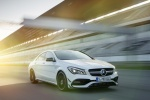 2017 Mercedes-Benz AMG CLA45 4-door Coupe in Cirrus White - Driving Front Right View