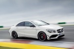 2018 Mercedes-Benz AMG CLA45 4-door Coupe in Cirrus White - Driving Front Right Three-quarter View