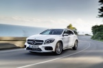 Picture of a driving 2019 Mercedes-AMG GLA 45 4MATIC in Polar White from a front left three-quarter perspective