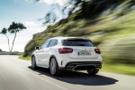 Picture of a driving 2019 Mercedes-AMG GLA 45 4MATIC in Polar White from a rear left perspective