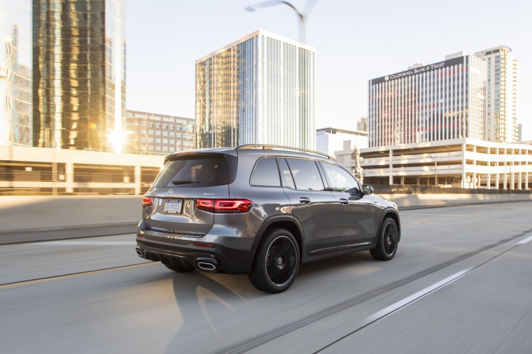 Driving 2020 Mercedes-Benz GLB 250 4MATIC in Mountain Gray Metallic from a rear right three-quarter view