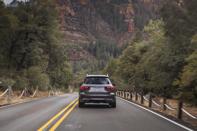 Driving 2020 Mercedes-Benz GLB 250 4MATIC in Mountain Gray Metallic from a rear view