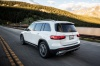 Driving 2020 Mercedes-Benz GLB 250 in Polar White from a rear left three-quarter view