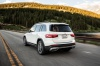 Driving 2020 Mercedes-Benz GLB 250 in Polar White from a rear left view