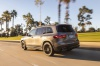 Driving 2020 Mercedes-Benz GLB 250 4MATIC in Mountain Gray Metallic from a rear left three-quarter view