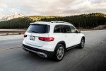 Picture of a driving 2020 Mercedes-Benz GLB 250 in Polar White from a rear right three-quarter perspective