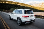 Picture of a driving 2020 Mercedes-Benz GLB 250 in Polar White from a rear left three-quarter perspective