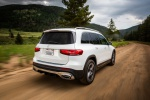 Picture of a driving 2020 Mercedes-Benz GLB 250 in Polar White from a rear right perspective