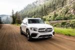 Picture of a driving 2020 Mercedes-Benz GLB 250 in Polar White from a front right perspective