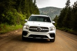 Picture of a driving 2020 Mercedes-Benz GLB 250 in Polar White from a frontal perspective