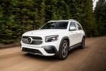 Picture of a driving 2020 Mercedes-Benz GLB 250 in Polar White from a front left perspective