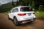 Picture of a driving 2020 Mercedes-Benz GLB 250 in Polar White from a rear left perspective