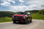Picture of a driving 2020 Mercedes-Benz GLB 250 in Patagonia Red Metallic from a front left perspective