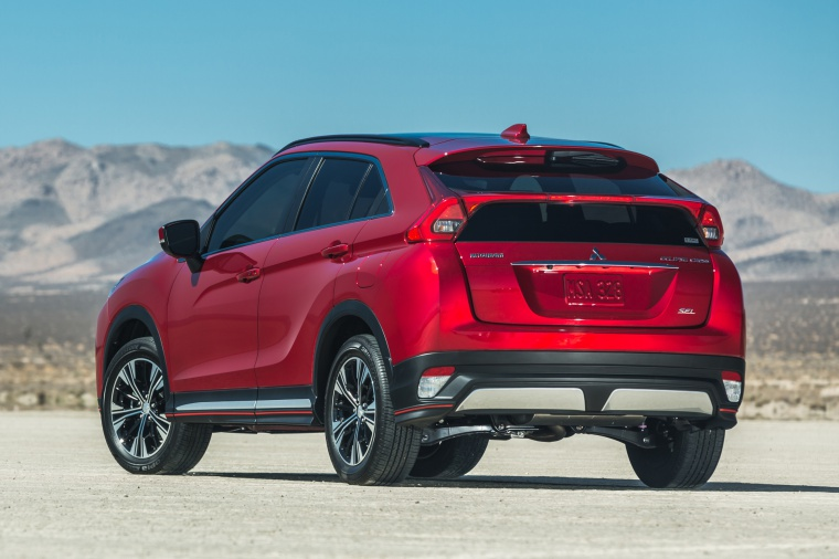 Picture of a 2019 Mitsubishi Eclipse Cross SEL S-AWC in Red Diamond from a rear left perspective