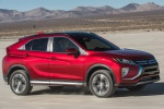 Picture of a driving 2019 Mitsubishi Eclipse Cross SEL S-AWC in Red Diamond from a front right three-quarter perspective