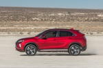 Picture of a driving 2019 Mitsubishi Eclipse Cross SEL S-AWC in Red Diamond from a left side perspective