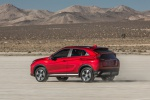 Picture of a driving 2019 Mitsubishi Eclipse Cross SEL S-AWC in Red Diamond from a rear left three-quarter perspective