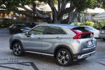 Picture of a 2019 Mitsubishi Eclipse Cross SEL S-AWC in Alloy Silver Metallic from a rear left three-quarter perspective