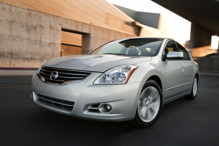 Driving 2010 Nissan Altima 3.5 SR in Radiant Silver Metallic from a front left view