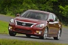 Driving 2015 Nissan Altima Sedan 3.5 SL in Cayenne Red Metallic from a front left view