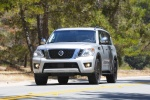 Picture of a driving 2017 Nissan Armada Platinum in Brilliant Silver from a frontal perspective