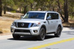 Picture of a driving 2017 Nissan Armada Platinum in Brilliant Silver from a front left perspective