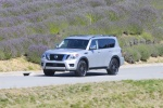 Picture of a driving 2017 Nissan Armada Platinum in Brilliant Silver from a front left three-quarter perspective