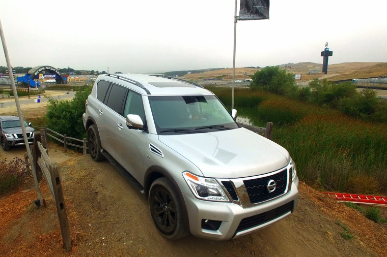 Driving 2018 Nissan Armada Platinum in Brilliant Silver from a front right view
