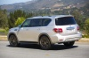 Driving 2018 Nissan Armada Platinum in Brilliant Silver from a rear left three-quarter view