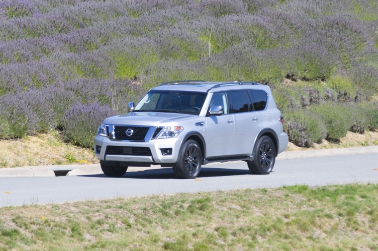 Picture of a driving 2019 Nissan Armada Platinum in Brilliant Silver from a front left three-quarter perspective