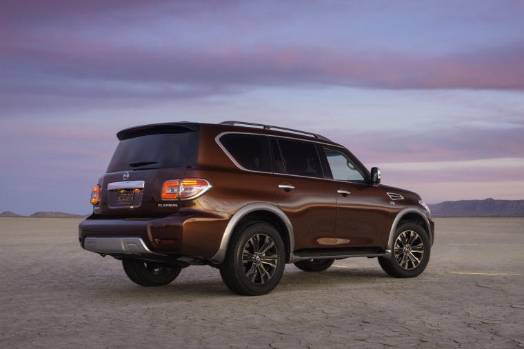 Picture of a 2020 Nissan Armada Platinum in Forged Copper Metallic from a rear right three-quarter perspective